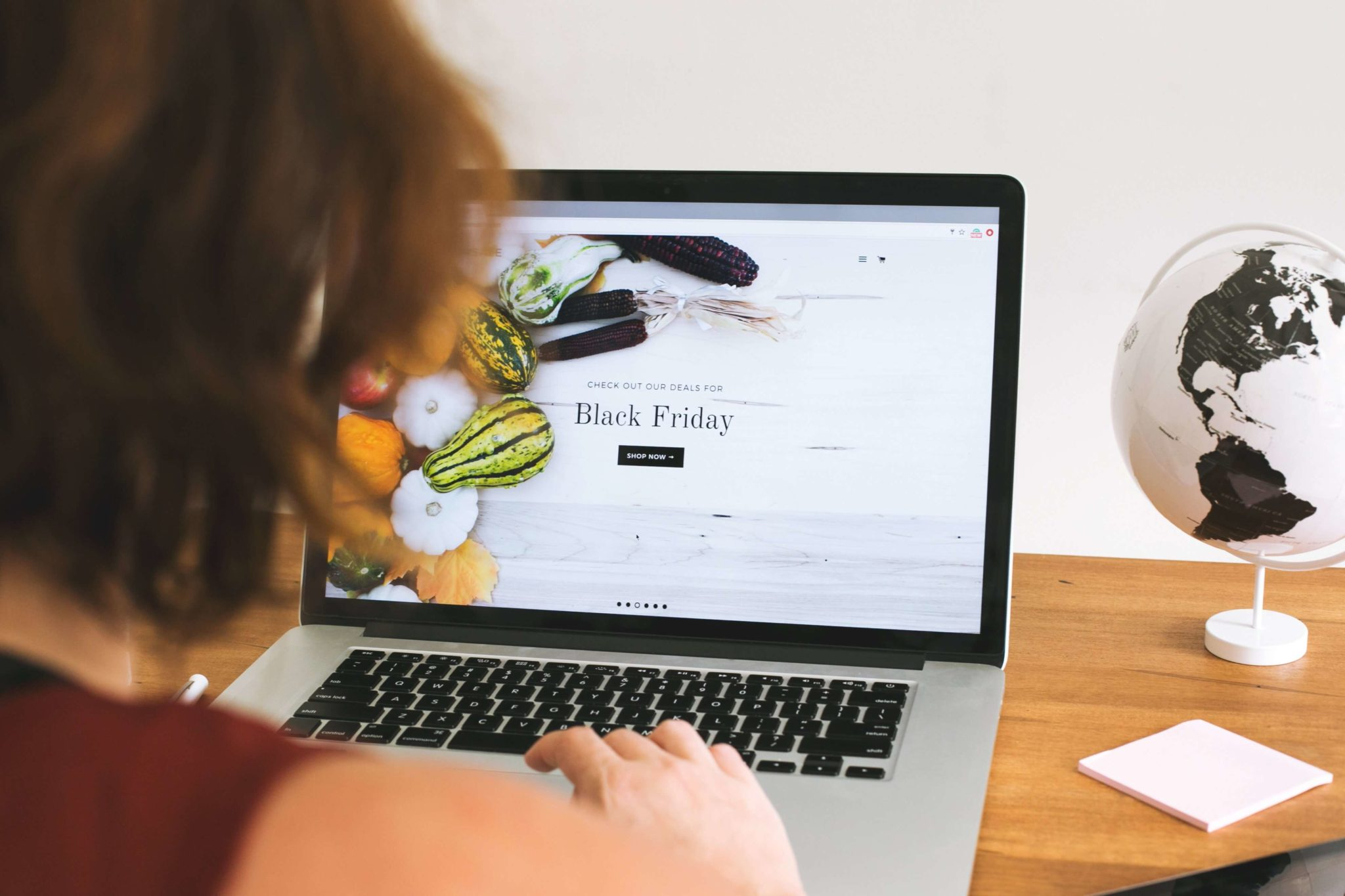 Woman looking at Shopify Theme